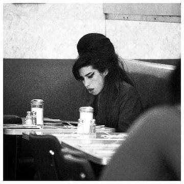 "Amy Winehouse // ""I'm a very romantic person. I don't mean romantic in a flowers and chocolate kind of way. It's more like if it's raining, I'll go up to the window and press my nose against the glass and sigh at how beautiful it all looks."""